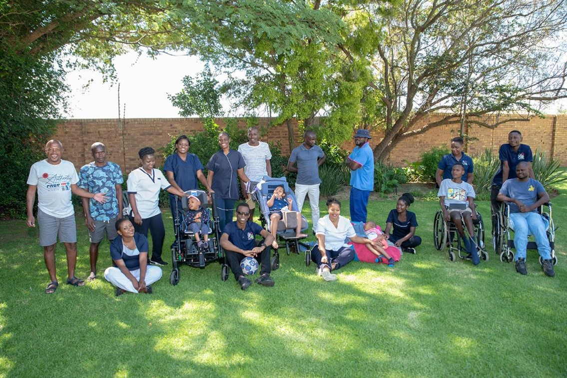 Our full team and residents enjoying the gardens